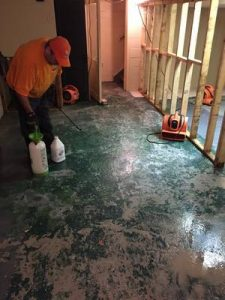 A Technician Remediating A Home After Water Damage
