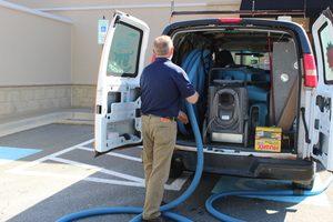 Disaster Restoration Van And Technician At JobSite