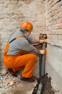 A Technician Checking A Pipe Burst For Mold